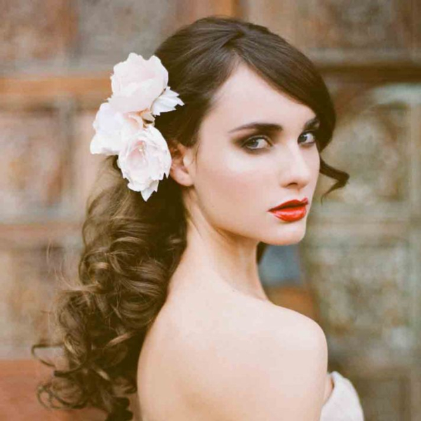 bridal hair style with flower